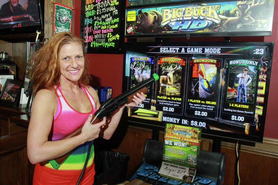 Kelly Folly with the Big Buck Hunter at Stats Sports Bar Photo: Gary Fountain, Freelance / Copyright 2013 Gary Fountain.