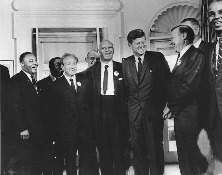 American president John F. Kennedy in the White House with leaders of the civil rights 'March on Washington' (left to right) Whitney Young, Dr Martin Luther King (1929  - 1968), Rabbi Joachim Prinz, A. Philip Randolph, President Kennedy, Walter Reuther (1907 - 1970) and Roy Wilkins. Behind Reuther is Vice-President Lyndon Johnson. Photo: Three Lions, Getty Images / Hulton Archive