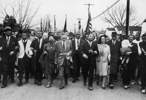 American civil rights campaigner Rev. Martin Luther King Jr. and his wife Coretta Scott King lead a black voting rights march from Selma, Alabama, to the state capital in Montgomery. Photo: William Lovelace, Getty Images / Hulton Archive