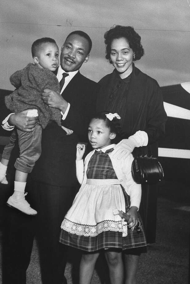 Rev. Martin Luther King Jr. holding his son Martin III as his daughter Bernice and wife Coretta greet him at the airport upon his release from Georgia State prison after incarceration for leading boycotts. Photo: Donald Uhrbrock, Time & Life Pictures/Getty Image / Donald Uhrbrock