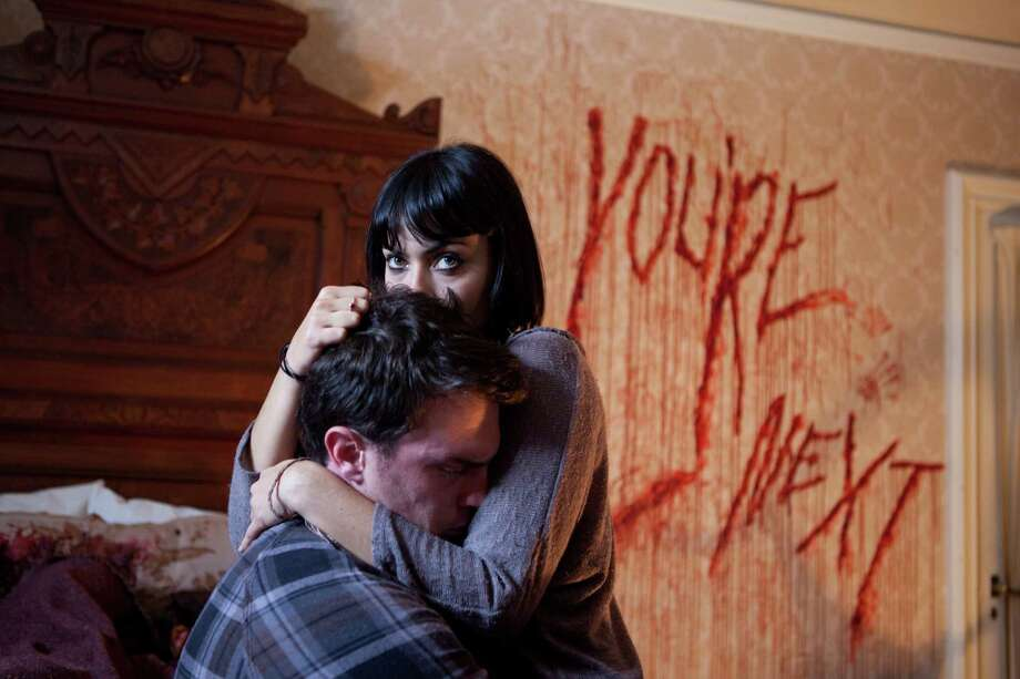 "Nick Tucci and Wendy Glenn star in ""You're Next."" Photo: Corey Ransberg, HOEP / Lionsgate"