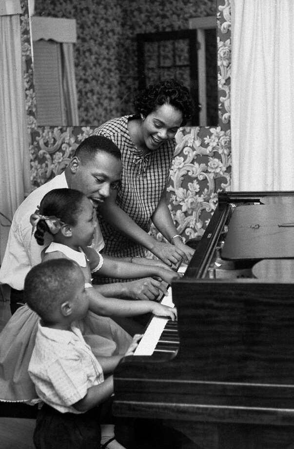 Civil Rights activist Rev. Rev. Martin Luther King Jr. and his wife Coretta, daughter Yolanda, 5, & Martin Luther III, 3, sitting together as they play piano in their living room. Photo: Donald Uhrbrock, Time & Life Pictures/Getty Image / Donald Uhrbrock