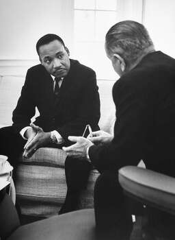 Civil rights leader Rev. Martin Luther King Jr. chatting head-to-head with Pres. Lyndon Johnson while sitting opposite him during his visit at the White House in 1963. Photo: Stan Wayman, Time & Life Pictures/Getty Image / Time Life Pictures