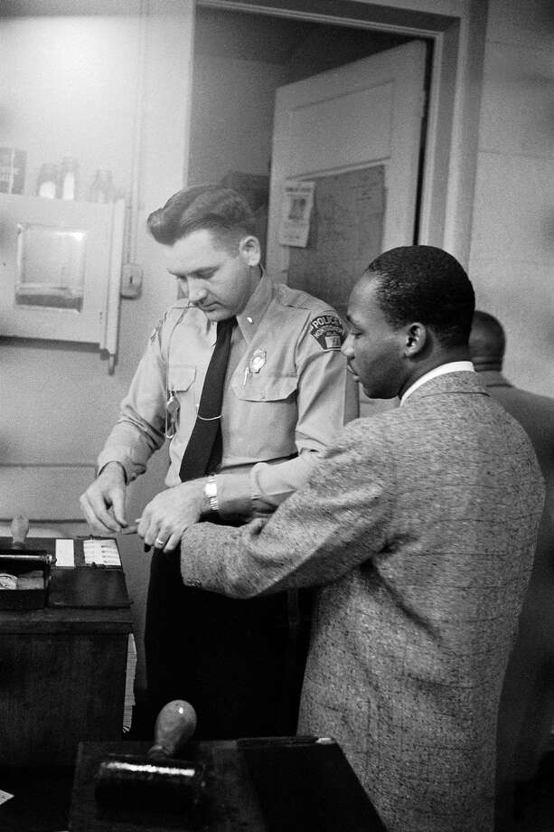 Civil rights leader Rev. Martin Luther King Jr. being fingerprinted by police after his arrest during the Montgomery bus boycott in 1956. Photo: Don Cravens, Time & Life Pictures/Getty Image / Don Cravens