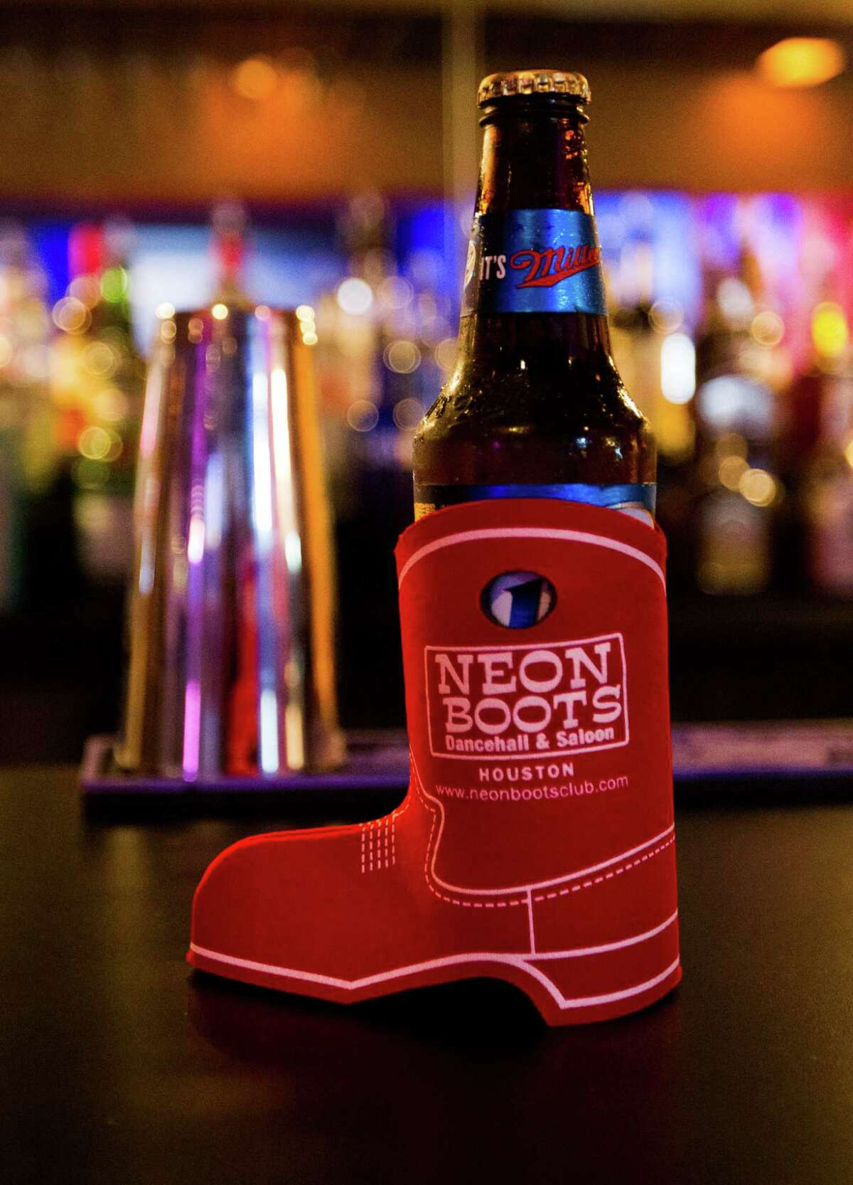A beer sits in a koozie at Neon Boots on Friday, Aug. 16, 2013, in Houston. ( J. Patric Schneider / For the Chronicle )