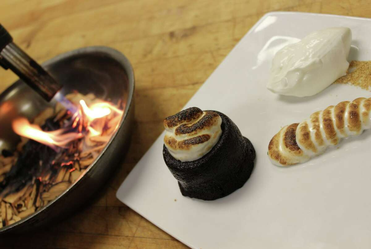 Vin Bar chef Shannen Tune tops off her Houston Restaurant Weeks menu with a Chocolate S'more. Smoke from burning wood chips is captured in an upside down wine glass that diners can tip over to enjoy the aroma of a camp fire.