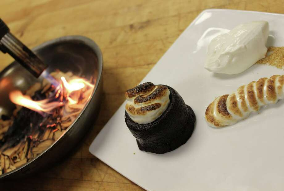 Vin Bar chef Shannen Tune tops off her Houston Restaurant Weeks menu with a Chocolate S'more. Smoke from burning wood chips is captured in an upside down wine glass that diners can tip over to enjoy the aroma of a camp fire. Photo: Courtesy Photo