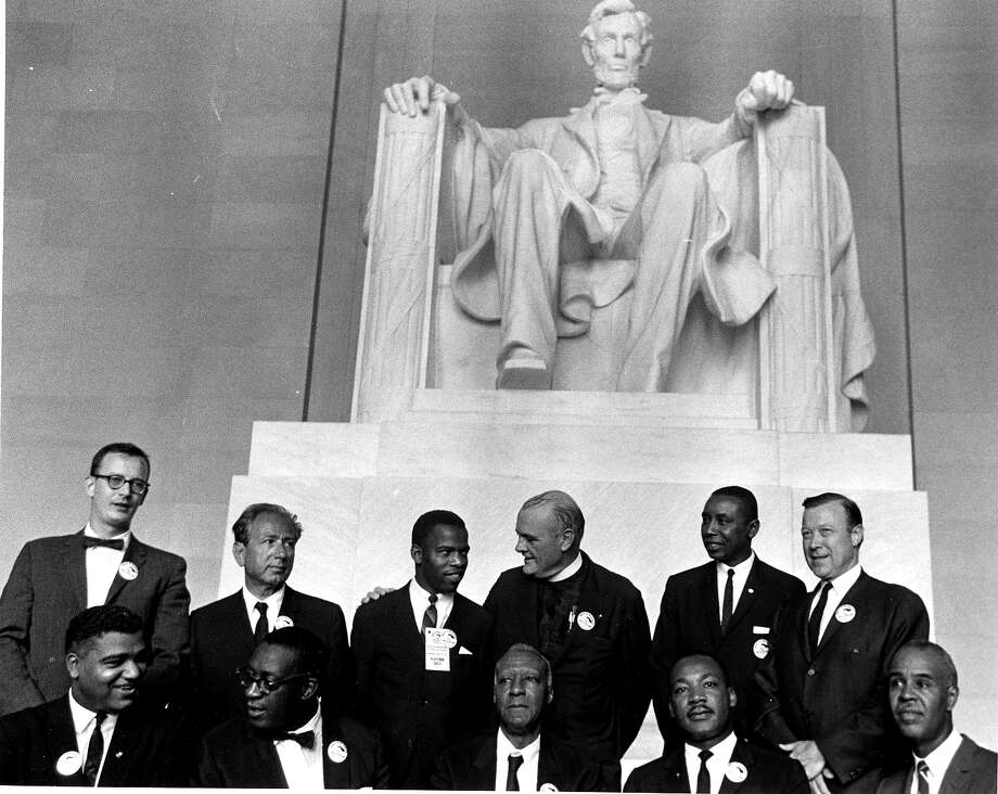 Civil Rights leaders pose in the Lincoln Memorial during the March on Washington for Jobs and Freedom, Washington DC, August 28, 1963. Pictured are, standing from left, director of the National Catholic Conference for Interracial Justice Matthew Ahmann, Rabbi Joachim Prinz (1902 - 1988), Student Nonviolent Coordinating Committee (SNCC) leader John Lewis, Protestant minister Eugene Carson Blake (1906 - 1985), Congress of Racial Equality (CORE) leader Floyd McKissick (1922 - 1991), and labor union leader Walter Reuther (1907 - 1970); sitting from left, National Urban League executive director Whitney Young (1921 - 1971), unidentified, labor union leader A Philip Randolph (1889 - 1979), Dr. Reverend Martin Luther King Jr. (1929 - 1968), and National Association for the Advancement of Colored People (NAACP) leader Roy Wilkins (1901 - 1981). The march and rally provided the setting for the Dr. King iconic 'I Have a Dream' speech. Photo: PhotoQuest, Getty Images / Archive Photos