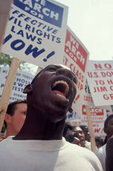 Close-up of a man, singing or shouting, among a larger crowd during the March on Washington for Jobs and Freedom, Washington DC, August 23, 1963. The march provided the setting for Rev. Marin Luther King Jr.'s iconic 'I Have a Dream' speech. Photo: Paul Schutzer, Time & Life Pictures/Getty Image / Time & Life Pictures