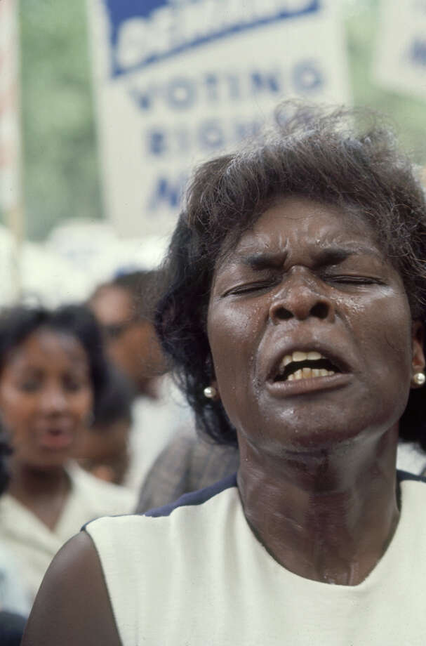 Close-up of a woman, among a larger crowd, her face contorted with emotion, during the March on Washington for Jobs and Freedom, Washington DC, August 23, 1963. The march provided the setting for Rev. Martin Luther King Jr.'s iconic 'I Have a Dream' speech. Photo: Paul Schutzer, Time & Life Pictures/Getty Image / Time & Life Pictures