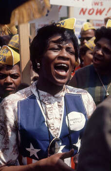 View of a woman, among others, as she sings during the March on Washington for Jobs and Freedom, Washington DC, August 23, 1963. The march provided the setting for Rev. Martin Luther King Jr.'s iconic 'I Have a Dream' speech. Photo: Paul Schutzer, Time & Life Pictures/Getty Image / Time & Life Pictures