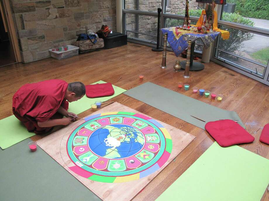 A monk works on the sand mandala at Silver Hill hospital in New Canaan. The monks did workshops and presentations with patients and the public during their six-day visit. Photo: Tyler Woods