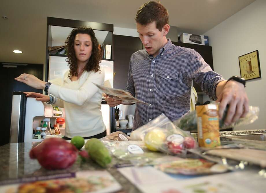 Julie Ingalls and Justin Overdorff organize by meal their first delivery from Blue Apron in San Francisco on August 20, 2013. Blue Apron is a new company that delivers weekly recipes and all the pre-measured ingredients to make three home-cooked meals a week to your door. Photo: Mathew Sumner, Special To The Chronicle