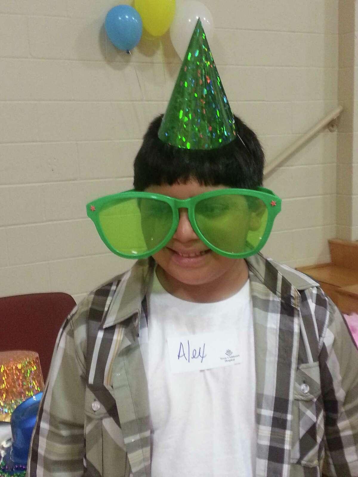 Texas Children's Hospital rehab outpatient Alex Ramirez enjoyed games and other activities at a recent reunion for former Inpatient Rehabilitation Unit patients.