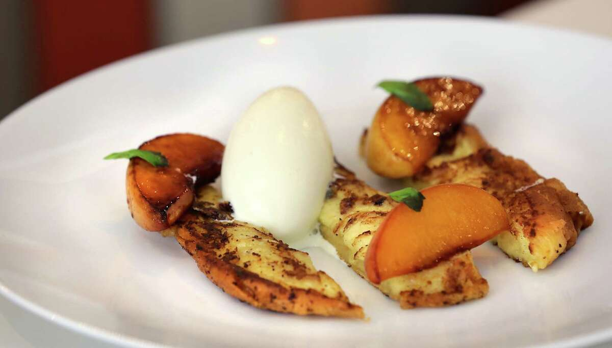 Brioche French Toast with Honey Roasted Peaches and Basil Ice Cream at Saveurs 209