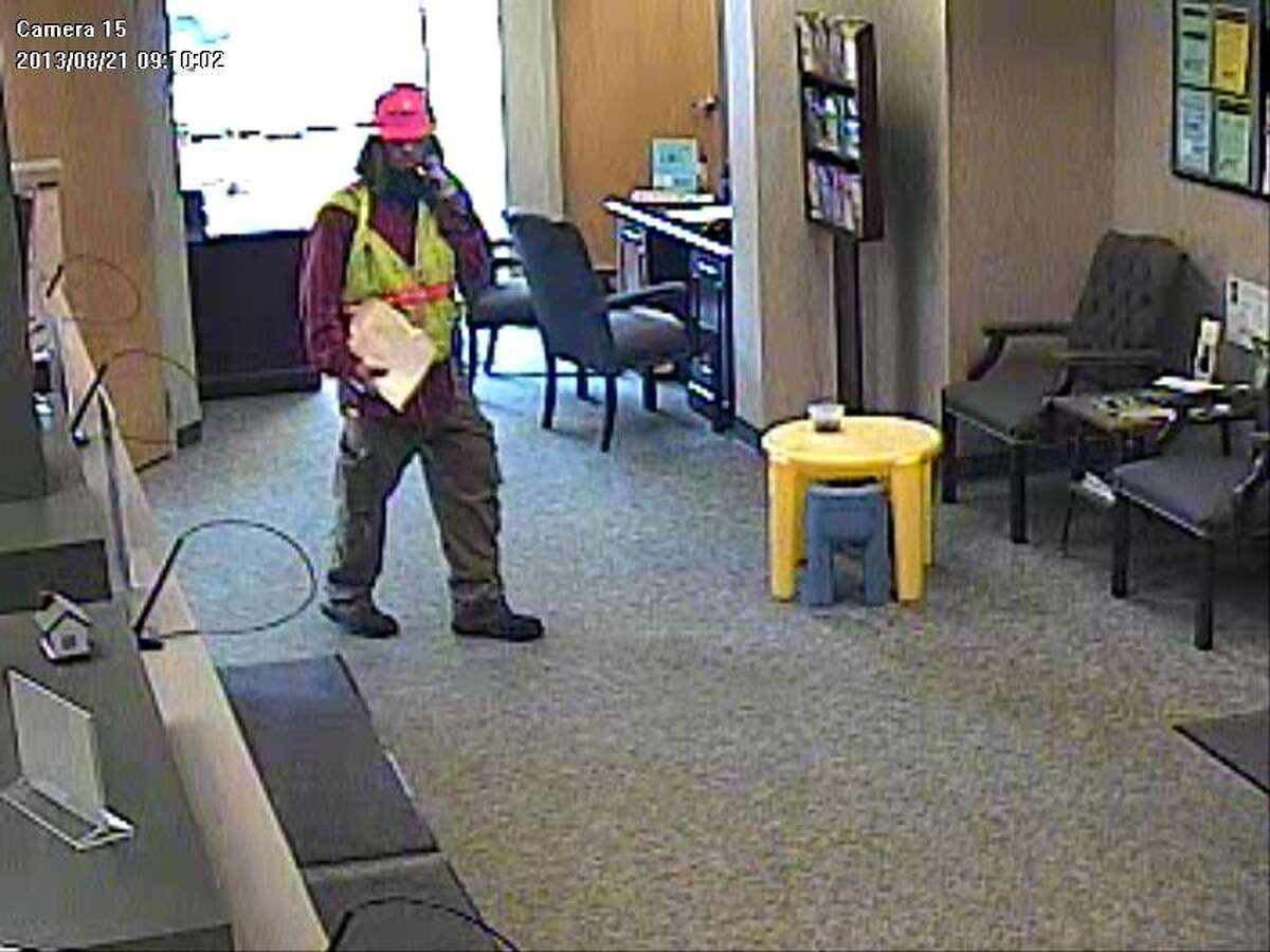 Bethlehem police released this surveillance picture from a video of an armed man wearing a hard hat and orange construction-workers vest during the robbery Wedndesday of a Trustco bank New Scotland Road in Slingerlands. (Bethlehem Police Department)