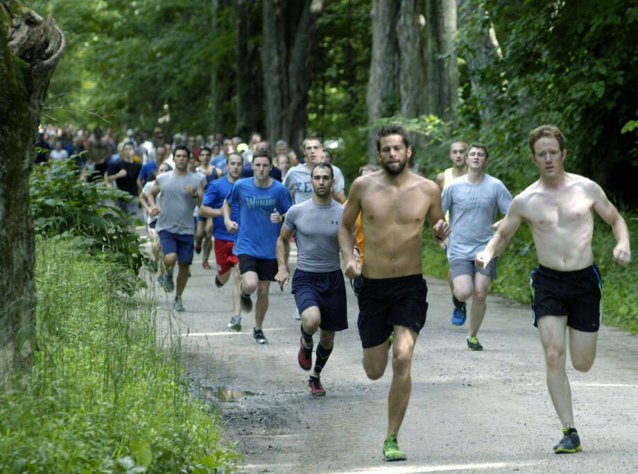 The field stretches out as the Stephen Reich Freedom Run 5K begins on the Fourth of July, 2013 at Steep Rock Reservation in Washington. Photo: Norm Cummings