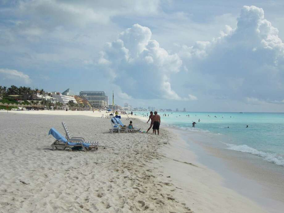 The Cancun, Mexico, hotel zone overlooks a broad white-sand beach that attracts sea turtles during egg-laying season. Many of the hotels operate programs to protect the eggs and to release baby turtles to the Caribbean Sea Photo: David Hendricks, San Antonio Express-News / San Antonio Express-News