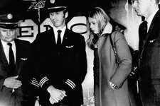 (L to R) Captain William Scott; First officer/copilot Robert Rataczak; flight attendant Tina Mucklow; and second officer Harold Anderson are shown here at a news conference in Reno, Nevada, after the arrival of Flight 305 to Reno International Airport. Two other members of the flight crew not pictured - Senior flight attendant Alice Hancock and flight attendant Florence Schaffner - had been released along with the 36 passengers earlier in Seattle. Photo date: November 25, 1971.