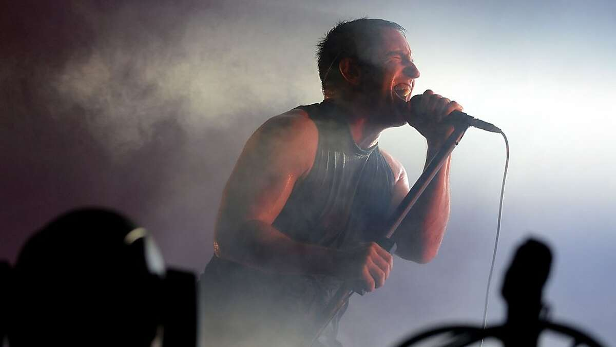 Trent Reznor of Nine Inch Nails. CHICAGO, IL - AUGUST 02: Trent Reznor of Nine Inch Nails performs during Lollapalooza 2013 at Grant Park on August 2, 2013 in Chicago, Illinois. (Photo by Theo Wargo/Getty Images)