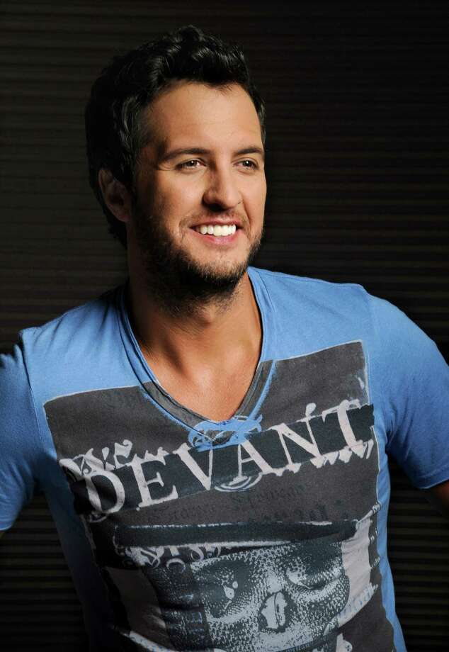 In this Tuesday, July 16, 2013 photo, Luke Bryan poses for a portrait at Audio Productions in Nashville, Tenn. Bryan has taken an unusual approach to the business side of his career since winning the Academy of Country Music's entertainer of the year in April: He's turning down almost everything. (Photo by Donn Jones/Invision/AP) ORG XMIT: TNDJ103 Photo: Donn Jones / Invision