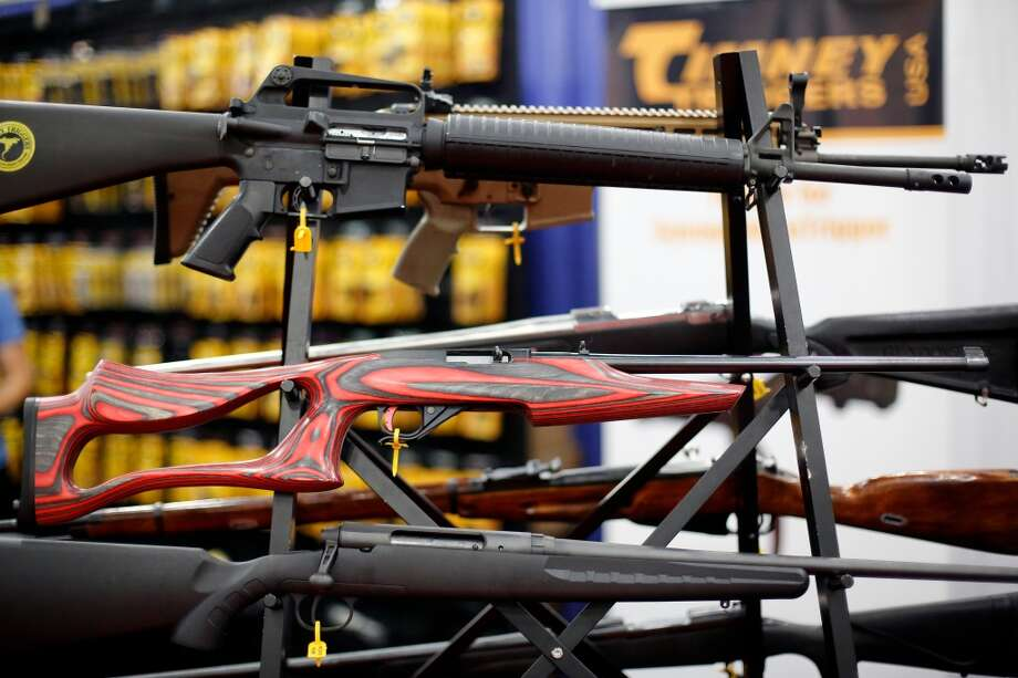 A display of crafted rifles is seen, during day 1 of the 142nd NRA annual meetings and exhibits, Friday, May 3, 2013 at the George R Brown convention center in  (TODD SPOTH FOR THE CHRONICLE) Photo: © TODD SPOTH, 2013