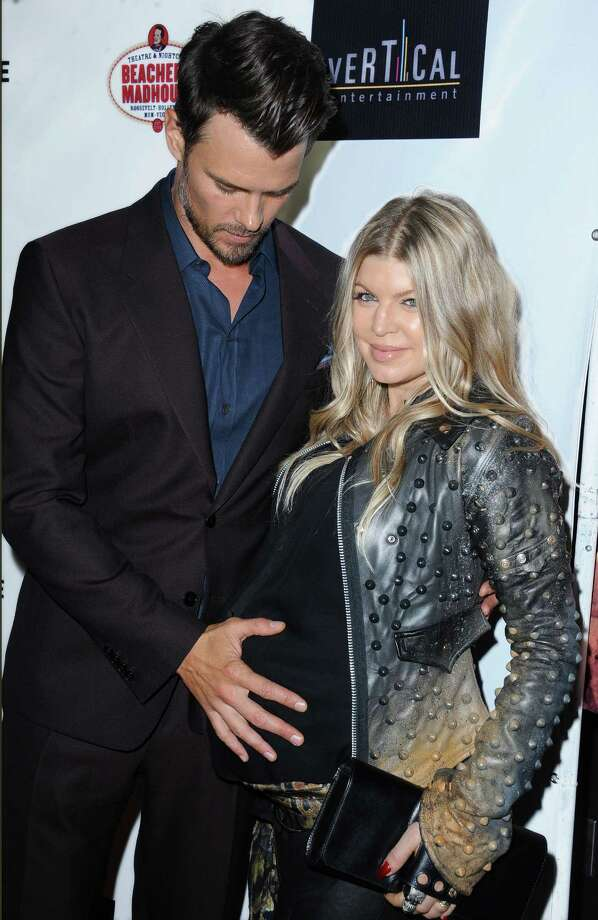 "Josh Duhamel, and his wife, Fergie, arrive on the red carpet for the premiere of ""Scenic Route"" at the Chinese 6 Theater on Tuesday, Aug. 20, 2013 in Los Angeles. (Photo by Katy Winn/Invision/AP) ORG XMIT: CAKW102 Photo: Katy Winn / Invision"