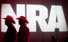 NRA members listen to speakers during the NRA Annual Meeting of Members at the National Rifle Association's 142 Annual Meetings and Exhibits in the George R. Brown Convention Center Saturday, May 4, 2013, in Houston.  The 2013 NRA Annual Meetings and Exhibits runs through Sunday, May 5.  More than 70,000 are expected to attend the event with more than 500 exhibitors represented. The convention will features training and education demos, the Antiques Guns and Gold Showcase, book signings, speakers including Glenn Beck, Ted Nugent and Sarah Palin as well as NRA Youth Day on Sunday ( Johnny Hanson / Houston Chronicle )