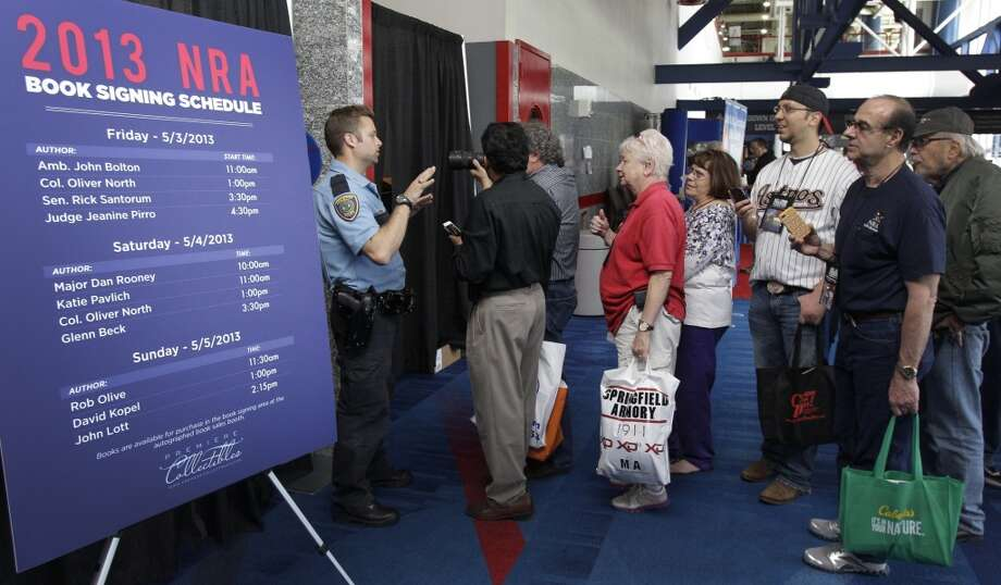 A Houston Police officer stops people from attempting to look behind curtain as they try to photograph Glenn Beck during his book signing event during the NRA convention at the George R. Brown Convention Center  Saturday, May 4, 2013, in Houston. ( Melissa Phillip / Houston Chronicle ) Photo: Houston Chronicle