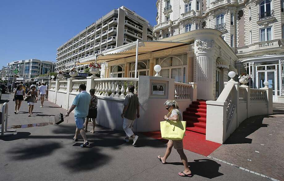 A view of the Carlton hotel, in Cannes, southern France, Tuesday, July 30, 2013, the scene of a daylight raid last Sunday, July 28. A staggering euro103 million ($136 million) worth of jewels and diamonds were stolen Sunday from the Carlton Intercontinental Hotel in Cannes, in one of Europe's biggest jewelry heists recent years, police said. French Riviera hotel was hosting a temporary jewelry exhibit over the summer of the prestigious Leviev diamond house, which is owned by Israeli billionaire Lev Leviev. (AP Photo/Lionel Cironneau) Photo: Lionel Cironneau, Associated Press