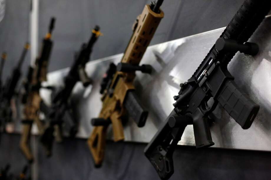 A wall of rifles is seen, during day 1 of the 142nd NRA annual meetings and exhibits, Friday, May 3, 2013 at the George R Brown convention center in  (TODD SPOTH FOR THE CHRONICLE) Photo: © TODD SPOTH, 2013