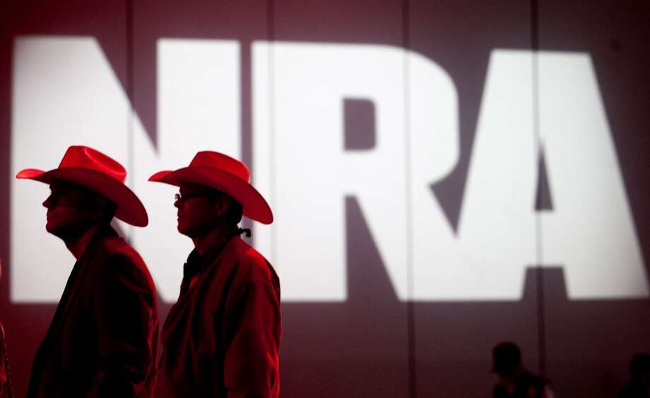 NRA members listen to speakers during the NRA Annual Meeting of Members at the National Rifle Association's 142 Annual Meetings and Exhibits .The NRA is trying to mobilized opposition to Initiative 1639, which would raise to 21 the minimum age for purchase of an assault rifle in Washington. Photo: Houston Chronicle