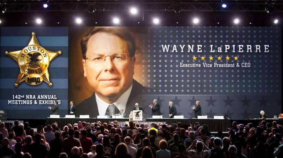 NRA executive vice president Wayne LaPierre is introduced during the NRA Annual Meeting of Members at the National Rifle Association's 142 Annual Meetings and Exhibits in the George R. Brown Convention Center Saturday, May 4, 2013, in Houston.  The 2013 NRA Annual Meetings and Exhibits runs through Sunday, May 5.  More than 70,000 are expected to attend the event with more than 500 exhibitors represented. The convention will features training and education demos, the Antiques Guns and Gold Showcase, book signings, speakers including Glenn Beck, Ted Nugent and Sarah Palin as well as NRA Youth Day on Sunday ( Johnny Hanson / Houston Chronicle ) Photo: Houston Chronicle