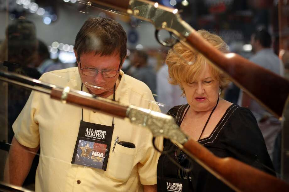 A couple looks at a display of rifles, during day 2 of the 142nd NRA annual meetings and exhibits, Saturday, May 4, 2013 at the George R Brown convention center in Houston, Texas. (TODD SPOTH FOR THE CHRONICLE) Photo: © TODD SPOTH, 2013