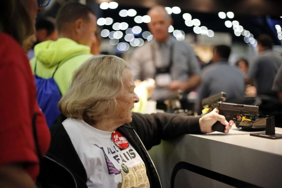 An expo attendee inspects a Glock pistol, during day 2 of the 142nd NRA annual meetings and exhibits, Saturday, May 4, 2013 at the George R Brown convention center in Houston, Texas. (TODD SPOTH FOR THE CHRONICLE) Photo: © TODD SPOTH, 2013