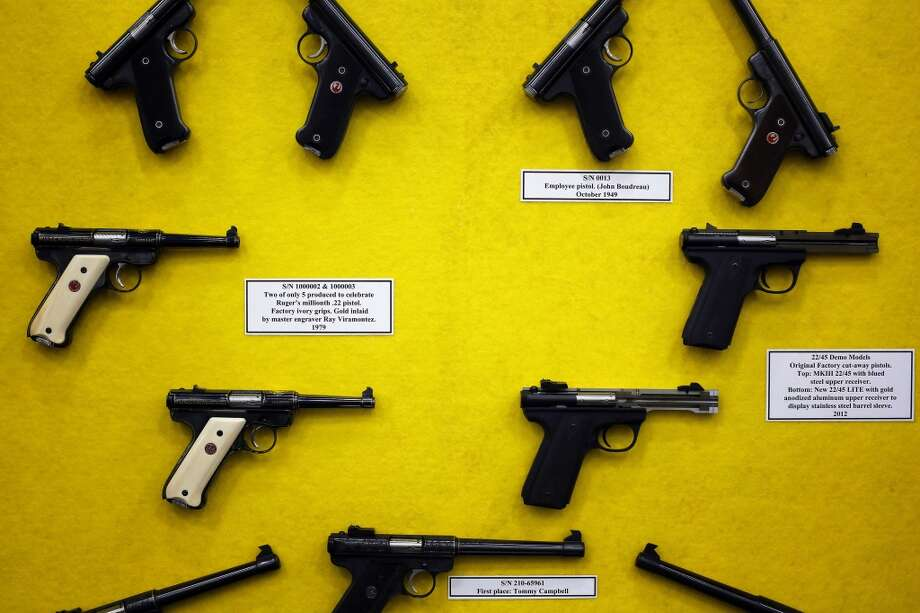 A display of vintage pistols is seen, during day 2 of the 142nd NRA annual meetings and exhibits, Saturday, May 4, 2013 at the George R Brown convention center in Houston, Texas. (TODD SPOTH FOR THE CHRONICLE) Photo: © TODD SPOTH, 2013