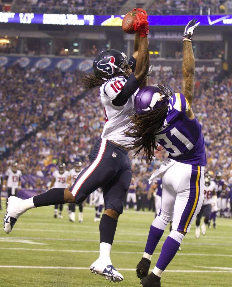 2013  Aug. 9: Texans 27, Vikings 13  Rookie DeAndre Hopkins' touchdown grab highlighted the Texans' win in Minny. Photo: Brett Coomer, Chronicle