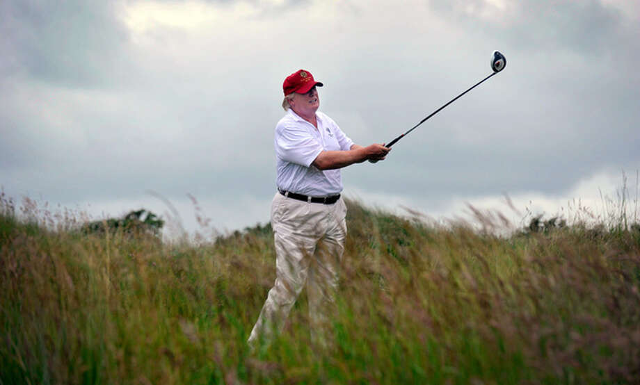 Donald Trump plays a stroke as he officially opens his new Trump International Golf Links course in Aberdeenshire, Scotland, in July 2012. Now, he is aggressively fighting Scottish plans to build 11 wind turbines off the coast overlooked by his golf course and other proposed projects. Photo: Andy Buchanan, AFP/Getty Images