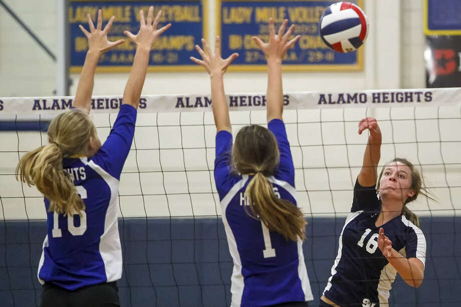 Smithson Valley's Allison Grona (right) and Victoria Gibbens jump to block a shot by Alamo Heights' Taylor Whitlock during their Tuesday match at Alamo Heights. The Lady Rangers fell to Alamo Heights in three straight sets. Photo: Marvin Pfeiffer / Bulverde News