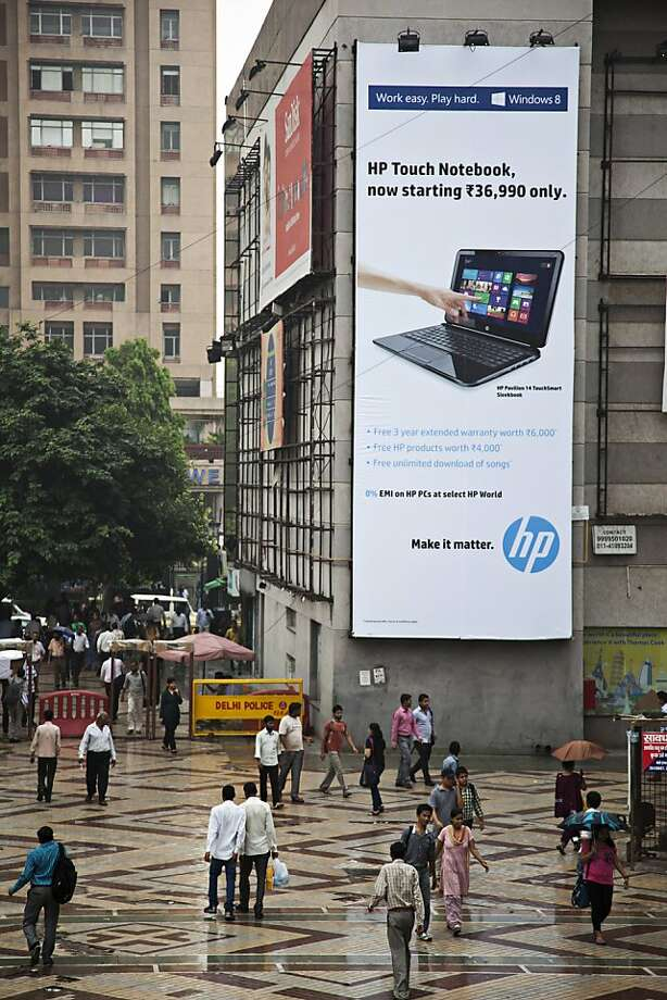 A Hewlett-Packard billboard towers over the entrance to Nehru Place IT Market, a hub for electronic goods and computer accessories, in New Delhi. Photo: Graham Crouch, Bloomberg