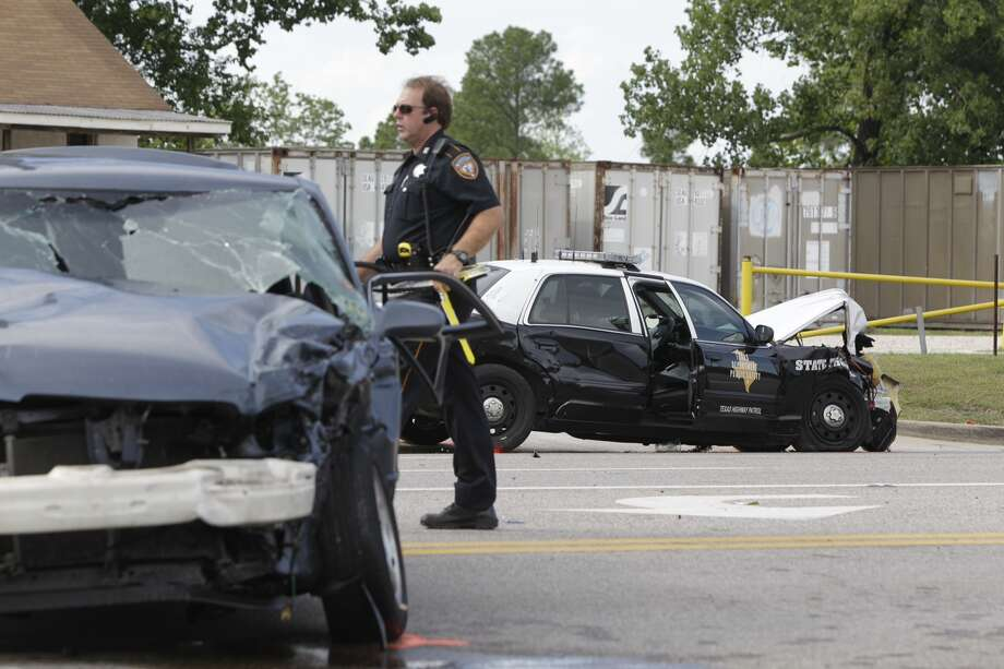 Police work at wreck involving a Texas State Trooper on FM 1960 and Solon Rd. Wednesday, Aug.  21, 2013. ( Melissa Phillip / Houston Chronicle)    Photo: Melissa Phillip, Houston Chronicle