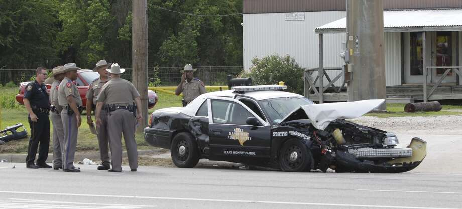Police work at wreck involving a Texas State Trooper on FM 1960 and Solon Rd. Wednesday, Aug. 21, 2013. (Melissa Phillip / Houston Chronicle) Photo: Melissa Phillip, Houston Chronicle