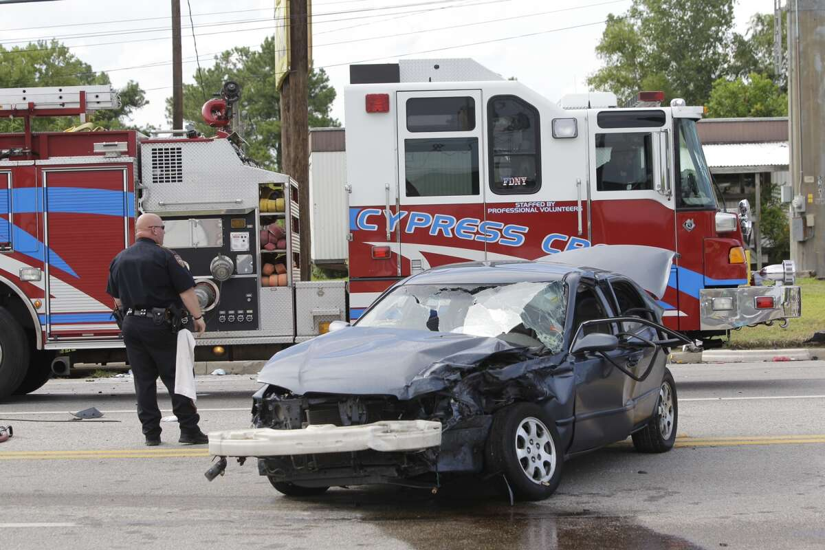 Police work at wreck involving a Texas State Trooper on FM 1960 and Solon Rd. Wednesday, Aug. 21, 2013. ( Melissa Phillip / Houston Chronicle)