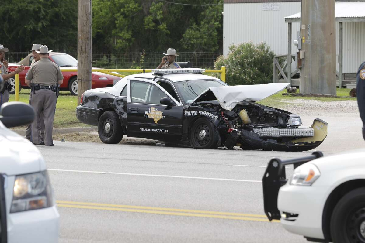 Police work at wreck involving a Texas State Trooper on FM 1960 and Solon Rd. Wednesday, Aug. 21, 2013. (Melissa Phillip / Houston Chronicle)