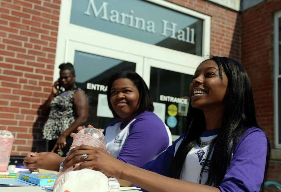 Students Alana Petinaud and Rodesha Luckett, both of Brooklyn, NY, talk about the physical improvements and renovations on the University of Bridgeport campus Wednesday, Aug. 21, 2013 at the school. Photo: Autumn Driscoll / Connecticut Post