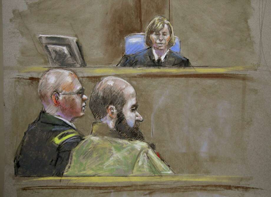 In this court room sketch, Judge Col. Tara Osborn, top, Maj. Nidal Malik Hasan, right, and defense attorney, Lt. Col. Kris Poppe, left, are shown, Wednesday, Aug. 21, 2013, in Fort Hood, Texas. Hasan rested his case Wednesday without calling any witnesses or testifying in his own defense. Hasan is accused of killing 13 people and wounding more than 30 others at the Texas military base in November 2009. (AP Photo/Brigitte Woosley) Photo: Brigitte Woosley, Associated Press / FR170958 AP