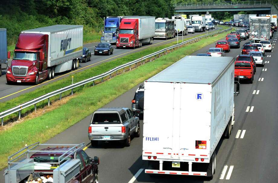 Traffic was stopped or moving at a snail's pace both east and west on Interstate 84 throughout much of the afternoon Wednesday, Aug. 21, 2013., because of accidents. This is the scene near Exit 8, in Danbury, Conn. Photo: Michael Duffy / The News-Times