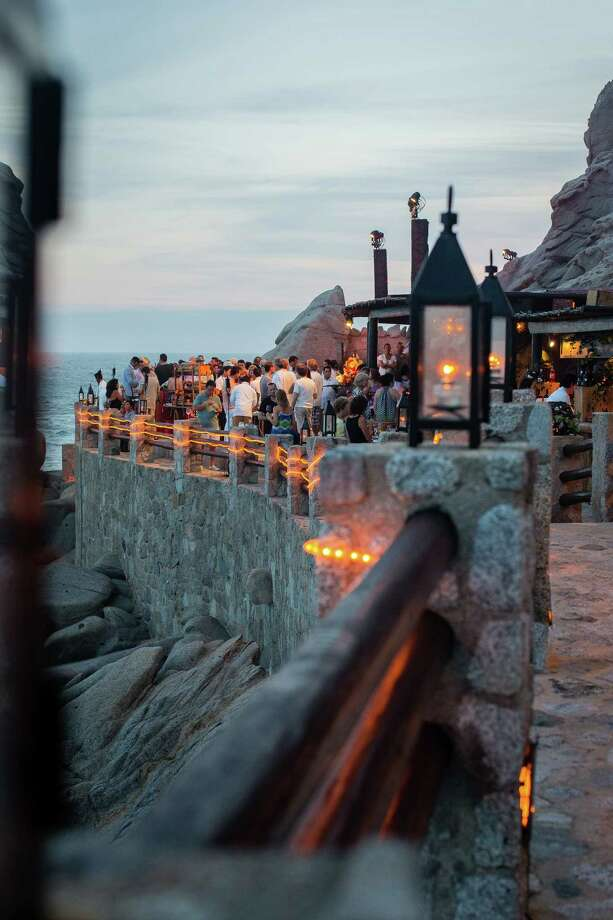 Capella Pedregal's seaside restaurant, El Farallon, clings to the cliffs overlooking the Pacific in Cabo San Lucas.Diners have to watch out for occasional rogue waves that roar in and splash over the cliffs. Photo: Amy Bennett / Capella Pedregal