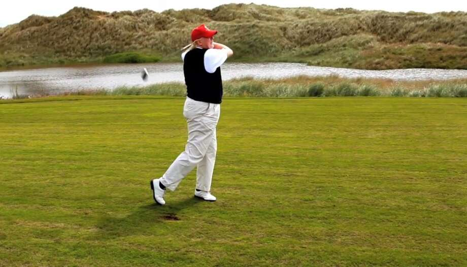 Donald Trump tees off on opening day at the Trump International Golf Links in July 2012. Photo: Trump International Golf Club Scotland Limited
