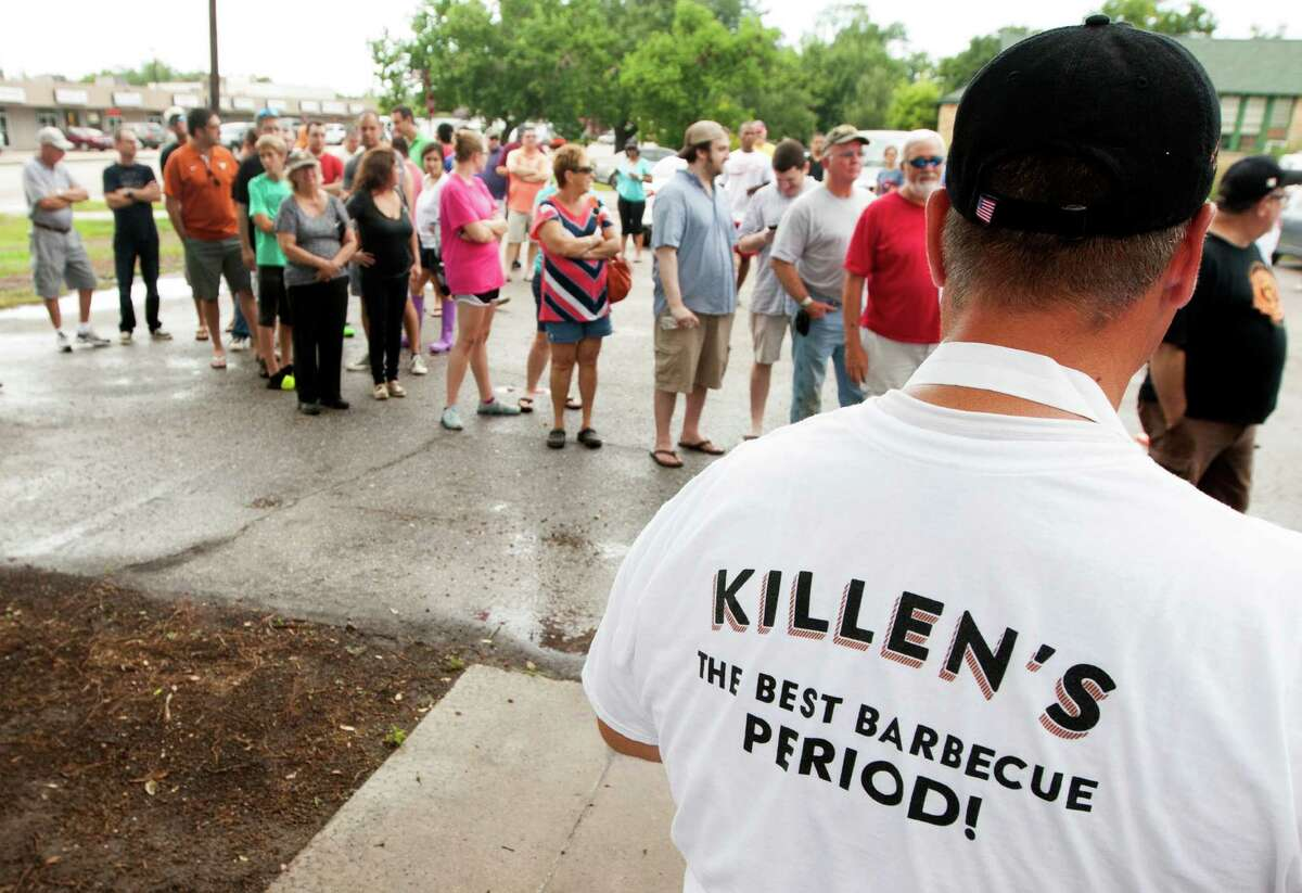 Customers line up outside on Saturday, Aug. 10, 2013, in Pearland. Ronnie Killen, known to all for his steakhouse is now readying an old school cafeteria in Pearland to be the new home of Killen's Barbecue. ( J. Patric Schneider / For the Chronicle )